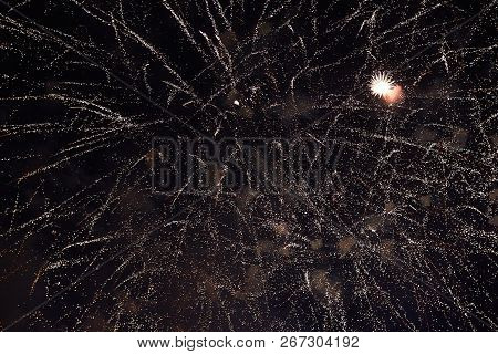 Fireworks In The Night Sky. Texture Salute. Abstract Photo Of Flares On A Black Background. Photos O