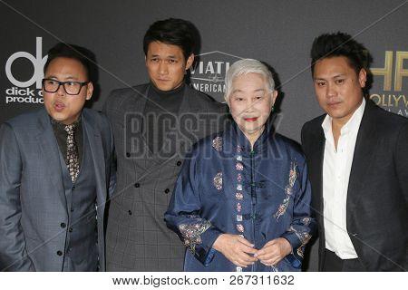 LOS ANGELES - NOV 4:  Nico Santos, Harry Shum Jr, Lisa Lu, Jon Chu at the Hollywood Film Awards 2018 at the Beverly Hilton Hotel on November 4, 2018 in Beverly Hills, CA