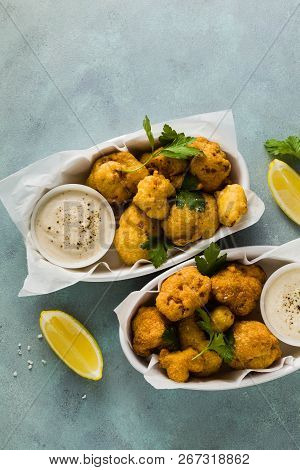 Fried Cauliflower In Batter With A Savory Sauce Of Cashew Nuts. Healthy Vegan Fast Food. Baked Buffa