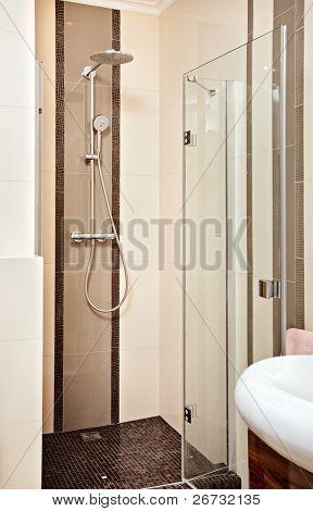 Shower cubicle in beige tones