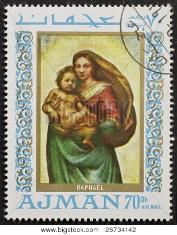 AJMAN (EMIRATE) - CIRCA 1968: a stamp printed in Ajman (UAE) shows a picture of Virgin Mary holding Child Jesus, painted by Raphael, the famous Italian Renaissance artist. Ajman, circa 1968