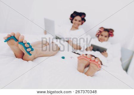 Fun Girl in the Beauty Saloon on Pedicure. Smile Little Girl and Happy Mother. Hairstyle for Beautiful Child. Cosmetic for Young GIrl. Little Girl and Happy Pedicure Together with Mother. Fun Girl. poster