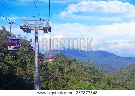 Genting Highlands, Malaysia - December 21 : Tourists Travel On Cable Car Of Genting Skyway. It Is A