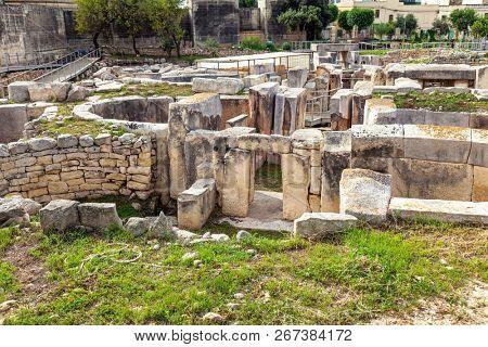 HAGAR QIM, MALTA - NOV 11, 2012: Hagar Qim, ancient Megalithic Temple of Malta, is a unesco world heritage site on the island nation of Malta.