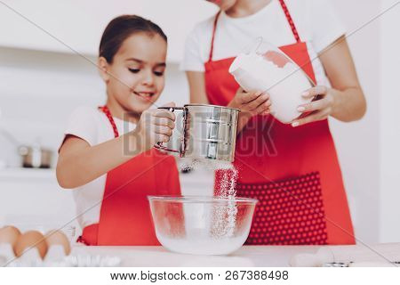 Young Girl Preparation Sugar For Sweet Biscuit And Sweet Pancakes. Mother Help Yung Girl With Prepar