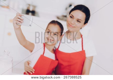Selfie And Preparation Cook In Apron. Photo With Mother And Preparation Sweet Breakfast. Cake For Pe