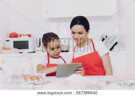 People In The Kitchen Cook Together With Mother And Daughter. Childhood With Mother In The Kitchen.