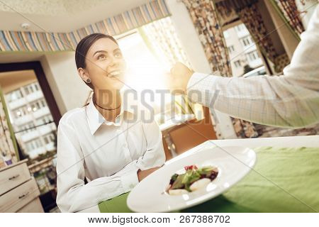 Happy Man And Woman Have Lunch In A Restaurant. A Smiling Couple, A Man And Women Are Enjoying Their