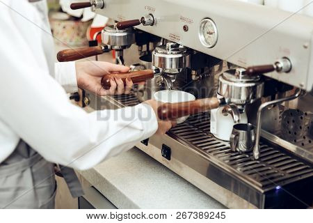 Close Up Of Female Barista Preparing Coffee. Barista Girl Makes Flavored Coffee For The Client. Coff