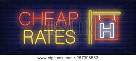 Cheap Rates Neon Sign. Glowing Inscription With Hotel Outdoor Signboard On Dark Blue Brick Backgroun