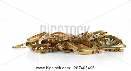 A Scrap Of Gold. Old And Broken Jewellery, Watches Of Gold And Gold-plated Isolated On A White Backg