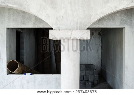 construction of the interior of a house made of gray cement started, unfinished construction of gray cement, interiors of a half-built house. poster