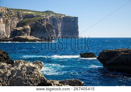 Amazing Fungus And Gebla Rock Cliffs With Rocky Coastline In The Dwejra Bay Beach Near Collapsed Azu