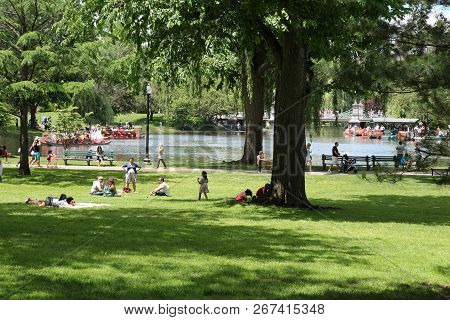 Boston, Usa - June 9, 2013: People Visit Famous Boston Common In Boston. It Is The Oldest City Park