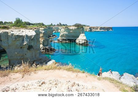 Sant Andrea, Apulia, Italy - May 30, 2017 - Tourists At The Cliffs Of Sant Andrea In Italy