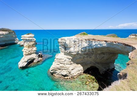 Sant Andrea, Apulia, Italy - Looking At The Huge Cave Arch Of The Rocky Coastline