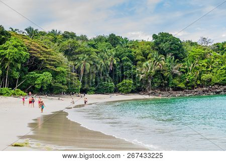Manuel Antonio, Costa Rica - May 13, 2016: Tourists On A Beach In National Park Manuel Antonio, Cost