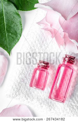 Organic Cosmetic With Rose Oil On White Background Top View