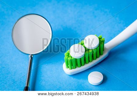 Concept Tooth Pain - Dentist Tools, Tablet At Blue Background