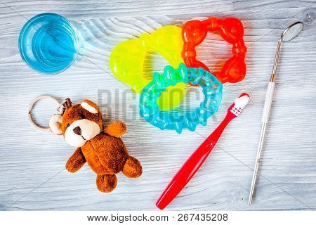 Childrens Toothbrush Oral Care On Wooden Background Top View