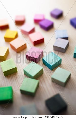 Roughly placed colorful wooden blocks with beautiful colors. All different colors. Extremely shallow depth of field.Roughly placed colorful wooden blocks with beautiful colors. All different colors.