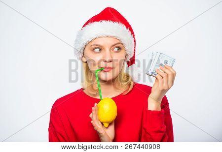 Lemon Money Concept. Girl Santa Hat Drink Juice Lemon While Hold Pile Money. Make Money On Fresh Lem