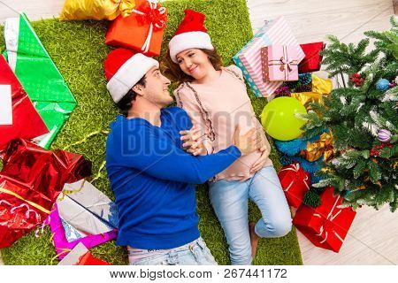 Pregnant wife celevrating christmas with husband