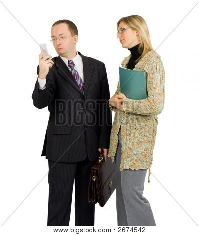 Businessman Distracted By Phone Call While Talking To A Pretty Female Colleague