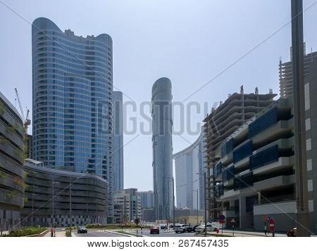 Shot Of Al Reem Island Towers, Landscape And Construction Sites On A Clear Blue Sky - Abu Dhabi, Uae