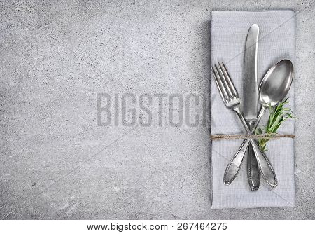 Table Setting Background With Copy Space. Concrete Background With Napkin, Silverware And Rosemary B