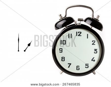 Iconic alarm clock and clock hands isolated on white