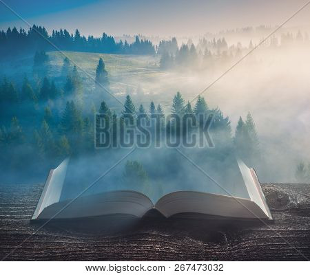 Beautiful Sunrise In A Carpathian Misty Valley On The Pages Of An Open Magical Book. Majestic Landsc