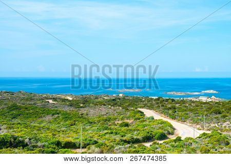 a view of La Tonnara place, on the Southern coast of Corsica, France, with the calm Mediterranean sea in the background