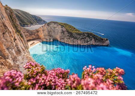 Navagio Beach With Shipwreck And Flowers On Zakynthos Island, Greece