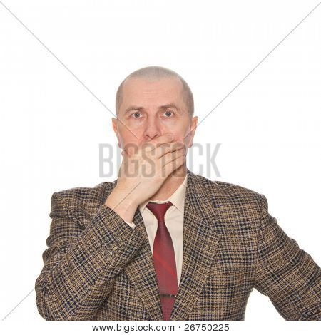A businessman holding his hand over his mouth. Isolated on white. Body language. Manifest of telling untruth. poster