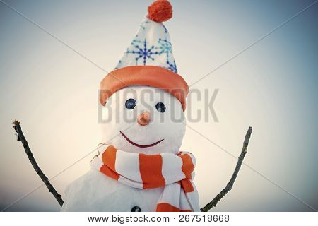 Snowman In Winter Outdoor. Xmas Or Christmas Decoration. New Year Snowman From Snow In Hat. Happy Ho