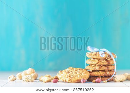 Christmas And New Year Composition With Delicious Peanut Cookies And Peanuts On Light Table And Blue