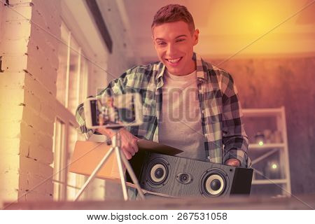 Cheerful Guy Introducing New Column For Music