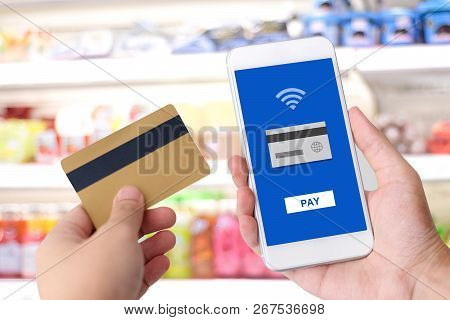 Hand Holding Credit Card And Smart Phone With Online Payment On Device Screen Background, Shopping O
