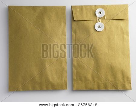 front and back of brown envelop on the plain background