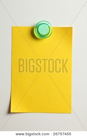 blank yellow note with magnet on the bridge