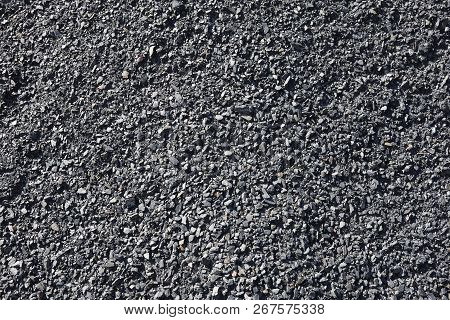 Black Charcoal Rocks Background. Polluting Energy. No Sustainable Sources. Horizontal