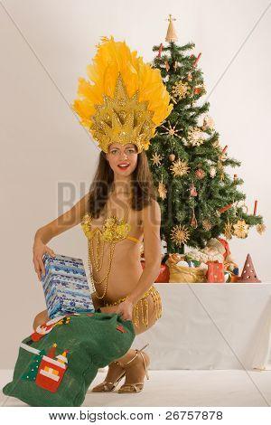 Samba girl from Santa Claus with sack
