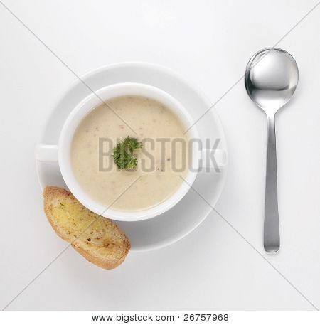 creamy soup with parsley ready to serve