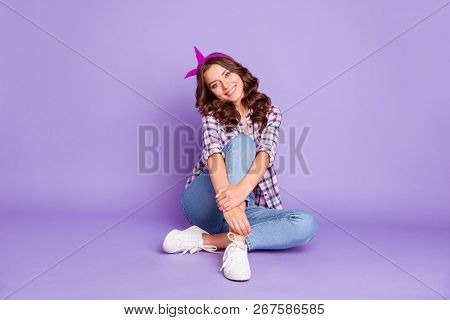 Full Size Portrait Of Careless Carefree Lady With Her Curly Hairstyle She Sit On Floor Look At Camer