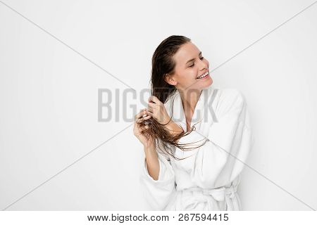 Beautiful Young Woman With Wet Hair In Bathrobe