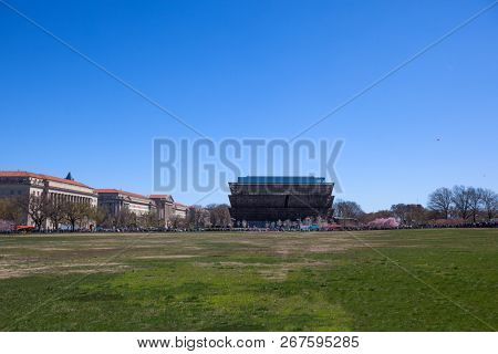 WASHINGTON, DC, USA - MARCH 31, 2018:  Exterior view of Smithsonian  National Museum of African American History and Culture (NMAAHC) on the Blossom Kite Festival  in Washington DC monumental park