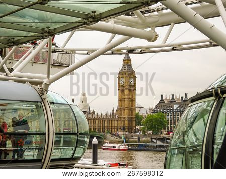 London, United Kingdom - June 10, 2013: London Eye On Thames River Embankment. View Of The Houses Of