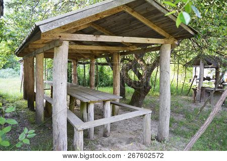 Beautiful Alcove, Wooden Arbor, Pavilion, Bower, Summer House, Garden House In The Rural Garden.