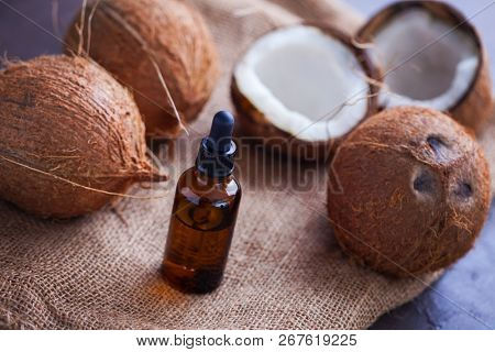 coconut oil with coconuts - beauty treatment